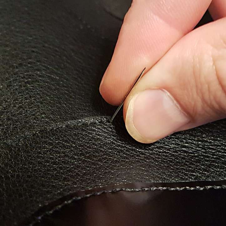 hand sewing leather.jpg