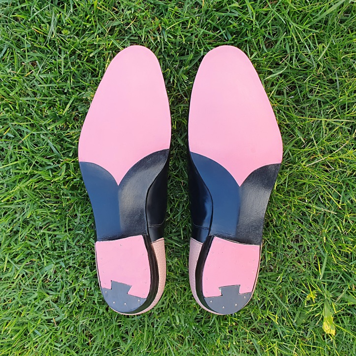 Pink outsoles grass